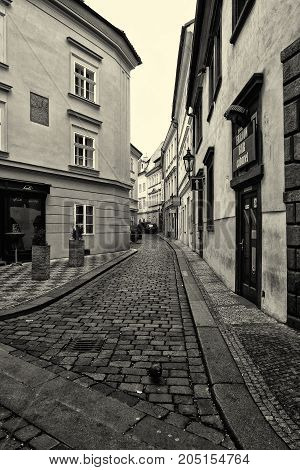 PRAGUE CZECH REPUBLIC - FEBRUARY 02 2014: The streets of old Prague. Stylized film. Large grains. Sepia. Prague is the capital and largest city of the Czech Republic