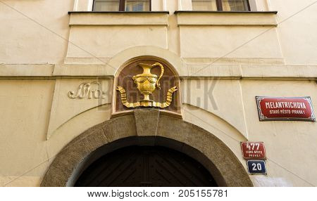 PRAGUE CZECH REPUBLIC - FEBRUARY 03 2014: Decoration in the form of a golden amphora over the arch. Old town of Prague.