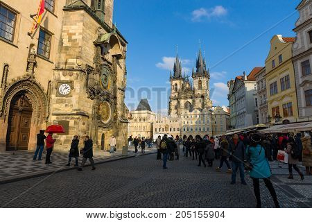 PRAGUE CZECH REPUBLIC - FEBRUARY 03 2014: Tourists on the Old Town Square in the heart of Old Town of the Prague. In the background Church of Mother of God in front of Tyn