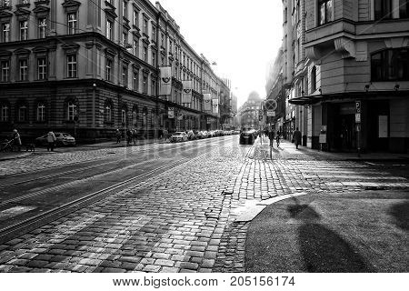 PRAGUE CZECH REPUBLIC - FEBRUARY 03 2014: The streets in the historic center of New Town of the Prague. Black and white. Stylized film. Large grains.