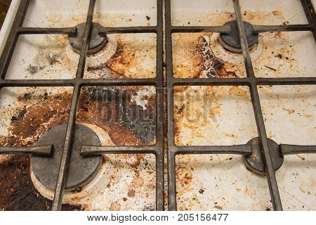 Very dirty gas stove stained while cooking
