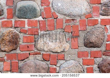 Wall of bricks and stones close up