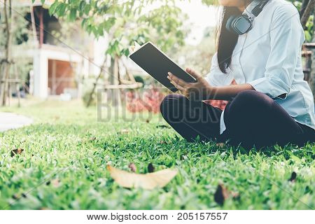Young business female using laptop while she is relaxing in coffee shop in the fresh air