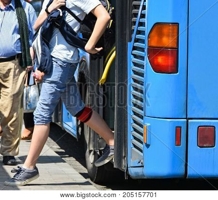 Blue bus at the stop in the city