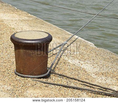 Bollard on the river bank in summer