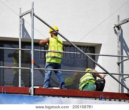 Construction workers at work on a construction frame