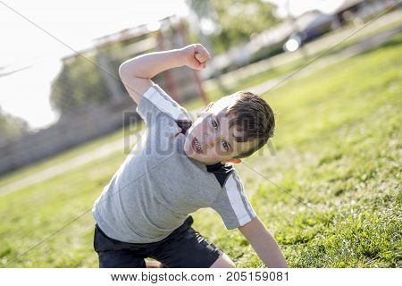 A Young caucassian soccer player football outside