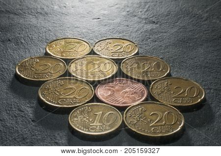 A mosaic of some euro cent coins