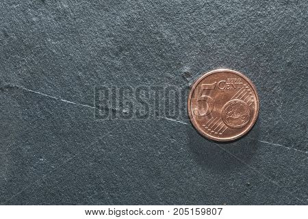 5 euro coin on a grey background