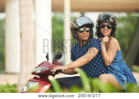 Couple traveling in the city on motorbike