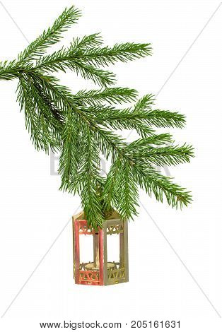Christmas fir tree branches with hanging toy decorative lantern lamp isolated on white background. Christmas decoration.