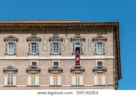 Rome, Italy - August 22, 2016:  Vatican Basilica of St Peter from the  Square. Pope Franciscus blessing the pilgrims from balcony.