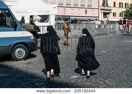 Rome, Italy - August 21, 2016: Two nuns in a military control against terrorism in Rome near Papal Basilica of Saint Mary Major.