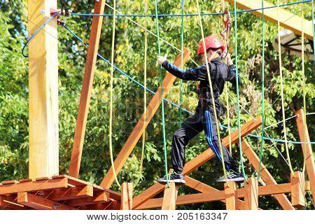 17 Sep 20.Russia Izhevsk. Rope Park a boy walks through the ropes.