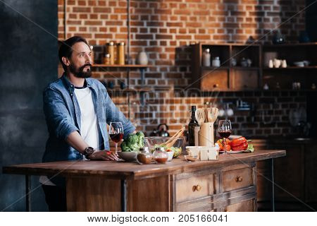 Man Drinking Wine While Cooking