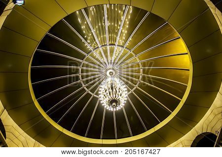 Beautiful chandelier on the ceiling with patterns