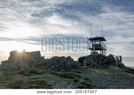 Wide angle view watching hut at dusk