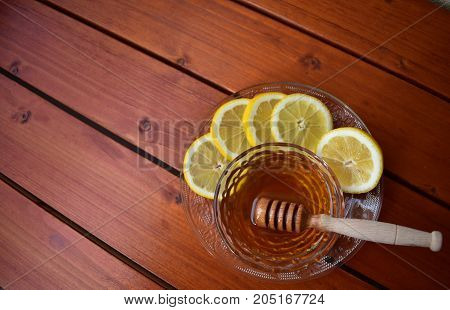 Honey and lemon as home remedy from winter colds.