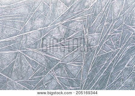 Frozen window ice pattern texture, snowflakes and icy background, close-up, soft focus.