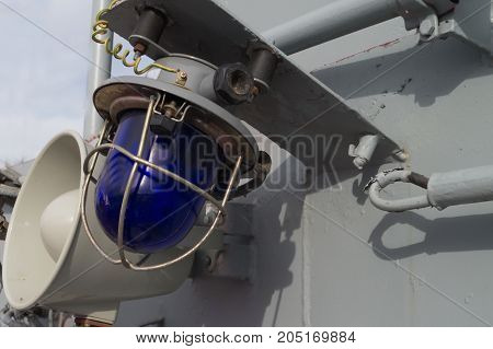 Military blue and white laterns and horn on the ship