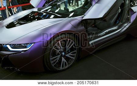 Sankt-Petersburg Russia July 21 2017: Luxury BMW i8 hybrid electric coupe. Plug-in hybrid sport car. Concept electric vehicle. Car exterior details. Photo Taken at Royal Auto Show July 21