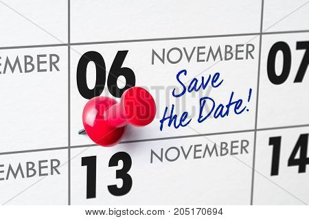 Wall Calendar With A Red Pin - November 06
