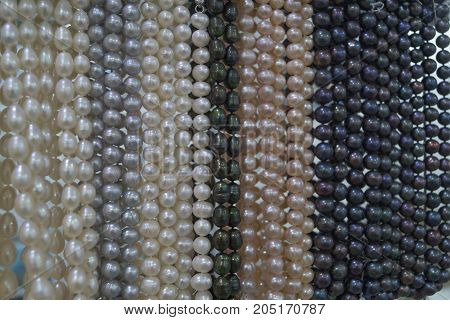 Black and white pearl beads background texture