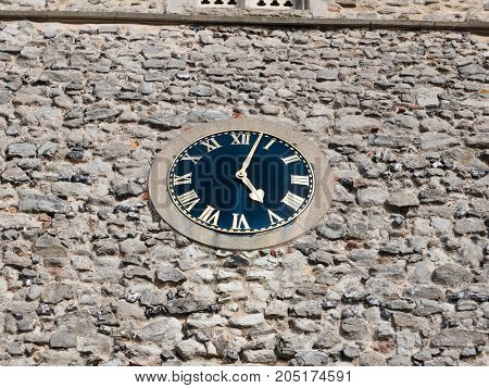Stunning Old Clock Outside On Church Brick Wall