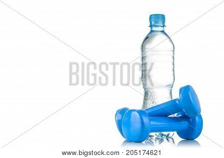 Fitnes symbols - red dumbbells a bottle of water and a towel. The concept of a healthy lifestyle.