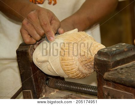Craftsman Carves Wooden Budha