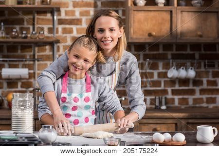 Mother Helping Daughter With Cooking