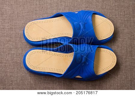Pair Of Blue Home Slippers With Leather Insoles. Top View.