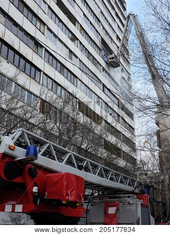 Fire with black smoke in multistory apartment building.