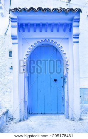 Traditional powder blue painted house facade and door in the historical Medina of Chefchaouen Morocco