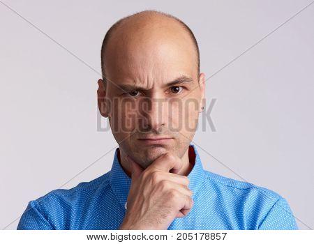 Serious Bald Man Thinking