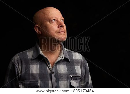 Senior Man Looking Up To Copy Space