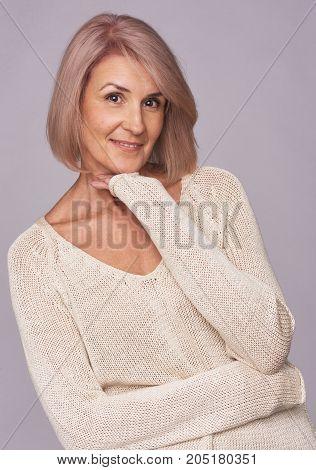 Beautiful Senior Woman Isolated On Grey