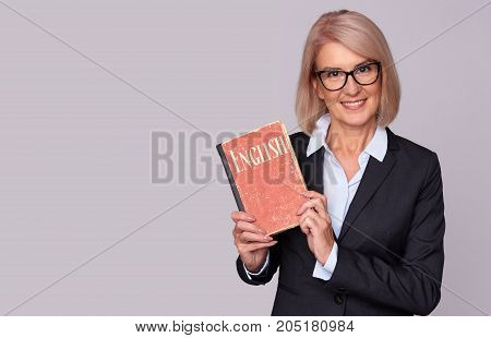 Teacher Holds A English Textbook