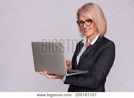 Smiling Middle Aged Woman With Laptop