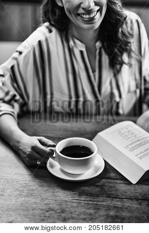 Woman Drinking Coffee And Reading Book,  Black And Whiite Image