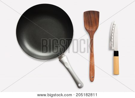 Top View frying and pan spatula and knife on white background