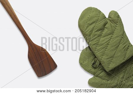 Top View a spatula and green glove on white background