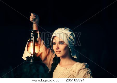 Medieval Woman with Vintage Lantern Outside at Night