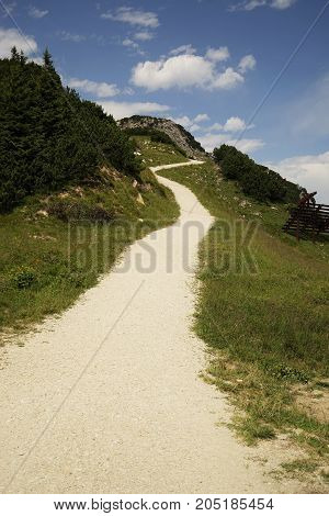 Mountain trail in the Tyrolean Alps under blue sky