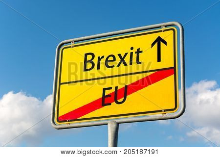 Yellow Street Sign With Brexit Ahead Leaving Eu Behind