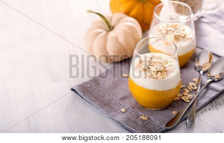 Overnight oats with pumpkin smoothie healthy cereal breakfast vegetarian food and dieting concept copy space
