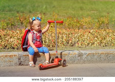 cute little girl tired of scooter ride, ambitious and pushy parent concept