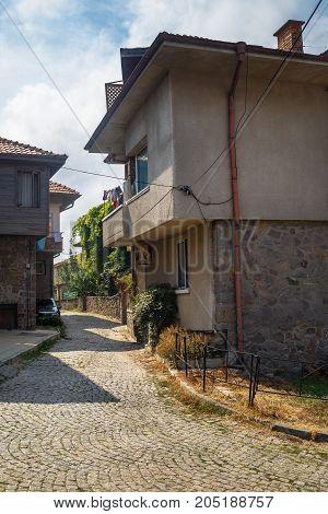 Sozopol Bulgaria - September 03 2014: Old town of Sozopol at Black Sea Burgas Region Bulgaria. Architecture and pavement. Vertical shot