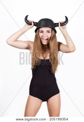 funny young woman in a swimsuit and helmet with horns.