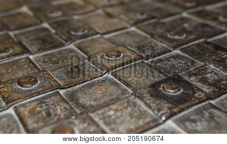 Elements of antique forging on the door. Close-up.